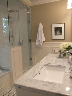 carrara marble tub deck and basket weave floor, shower and carrara marble countertop, retangular sink