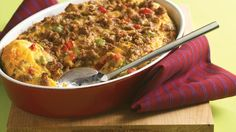 Decorate your brunch buffet with a fabulous egg casserole, decked with red and green peppers and a tender no-fuss crust.