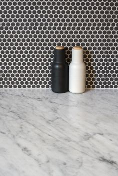 Monochromatic style with Carrara Marble bench and charcoal spot tile splashback Photography by @rachellewisphotography #cdkstone #carrara #carraramarble #marble #benchtops #splashbacks #naturalstone #naturalbeauty #naturesmasterpiece #designinspiration #designstyle