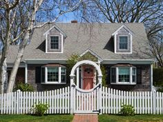 Cape Cod style home: This popular New England-style house is commonly recognized by its steep roof and small, protruding windows.