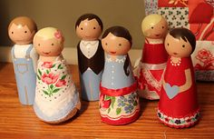 wooden dolls with skirts made out of vintage hankies