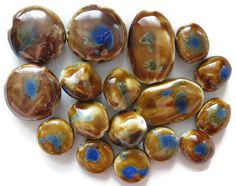 For all your jewelry making, arts and crafts projects, these beautiful ceramic beads range in size from 37mm to 18mm and are a pretty golden brown with blue accents.