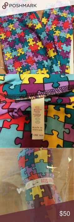 LuLaRoe puzzle piece os leggings NWT lularoe puzzle piece leggings.  Smoke free home. LuLaRoe Pants