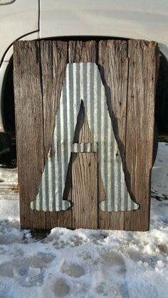 Old Barnwood,  cut corrigated tin for Monogram sign.