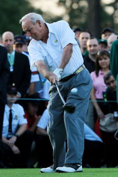 Honorary starter Arnold Palmer hits a tee shot on the first hole to start the first round of the 2012 Masters Tournament