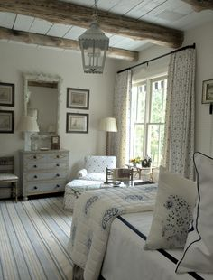 Cottage bedroom.Ceiling beams, white with one to two color accents