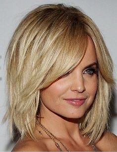 This flirty bob hairstyles for medium thick straight hair with side bangs and layers still on trend for round face women with light ash blonde hair color