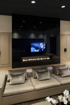 While every movie has a story to be told, be in comfort while being told that story #Fireplace #Movies #Hollywood #FireplaceDesign