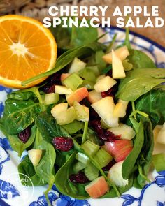 This cherry apple spinach salad is crunchy apples and celery, healthy spinach, tart dried cherries, with fresh orange juice and honey drizzled over the top.