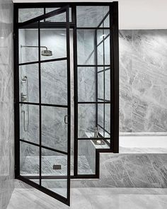 Bathroom New York ODA New York. Photo Frank Oudeman/Otto #bathroom #bathroomdesign #marble #blackframes #NYCapartment #shower #marblebathroom #bathroomdesign #showerscreen