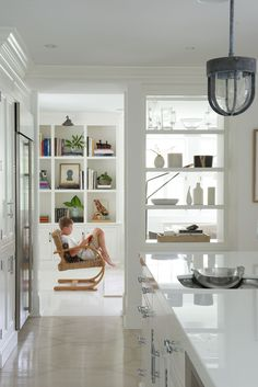 The removal of one kitchen wall allowed for direct access to the living area (and built-in shelving by Hemingway Custom Cabinetry).