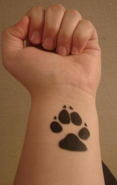 Black Paw Print Tattoo - Thinking about getting this on my back with Persephone's name under it.