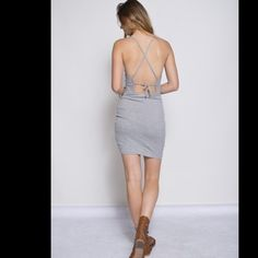 Solid tank dress  Description- Solid Tank Dress with cross straps on back  Material-96% Rayon, 4% Spandex Dresses Midi