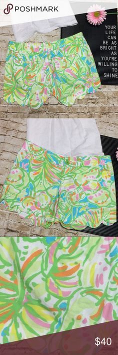 """Lilly Pulitzer Buttercup Shorts - Elephant Ears 2 Flawless condition Buttercup Shorts by Lilly Pulitzer in the Elephant Ears 2 print. Gorgeous pattern of yellow, green, pink and white. Scalloped hems. Front and back pockets. Zip fly with button. Modest length and flattering fit. 100% cotton.   Measurements lying flat: • Waist: 16"""" across • Rise: 7.5"""" • Inseam: 5"""" Lilly Pulitzer Shorts"""