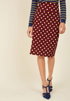 From meetings with your publisher to extensive book tours, your schedule never stops - good thing this burgundy pencil skirt can keep up! Perfectly polished, playful its taupe dots, and definitely retro from its timeless silhouette, this textured midi pleasurably partakes in your endless successes.