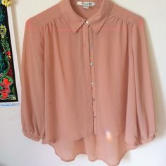 3 for $20 Sheer salmon low back top Only worn once. Semi sheer salmon button up. Low back top. Pink-ish salmon color :) ask questions offers accepted Forever 21 Tops