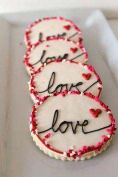 Love round cookies edged in sprinkles hearts pink red valentines cookies sugar cookies iced