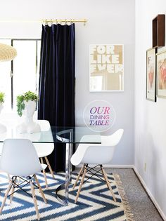 love this dining room: eames chairs, modern glass/metal table, chevron rug, velvet curtains + graphic art to boot.