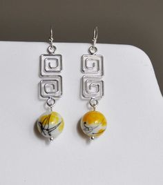 Yellow swirl stone with square swirl wire earring by cherriesshop, $14.00