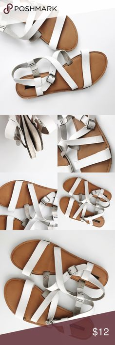 White Strappy Sandals Worn twice, excellent condition. Faux leather strappy design. Some slight scuffs, hardly noticeable. Silver hardware buckle closure. Very comfortable! NO TRADES. Forever 21 Shoes Sandals