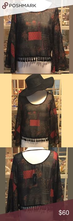 NEW Beautiful Romeo & Juliet Couture Tassel Blouse NEW Beautiful Romeo & Juliet Couture Tassel Blouse  Never been worn with tags; excellent condition 100% Polyester Hand wash cold; for best results Dry Clean Romeo & Juliet Couture Tops Blouses