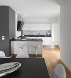 Modern Italy House Design with Cozy Atmosphere: Open Am House Semi Galley Kitchen Seen From Formal Dining Room With Clean Base And Wall Cabinetry