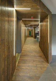 The wooden tunnel feature that includes concealed storage, and iGuzzini iN30 on the ceiling and walls