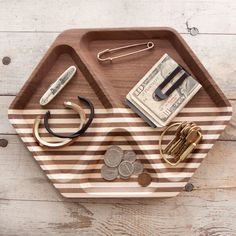 Solid American Walnutwith Maple stripes, finished with a durable, low-sheen varnish. Threegeometric compartments toaccommodate endless combinations of ac...
