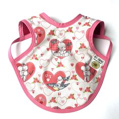 This is the perfect Kewpie Doll full coverage baby bib to keep your little one nice and tidy during feeding time or super dry if you have an all day drooler. As a mom of 4 boys, I know the reality and results of putting a traditional baby bib on a little one. Mealtime fallout or all day