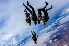 2015 Year in Pictures : The U.S. Army Golden Knights Vertical Formation Skydiving Team complete a practice jump during day one of the U.S. Nationals competition