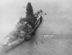 View of the Imperial Japanese Navy battleship Nagato as it lay in ruins in Tokyo harbor Japan 1945