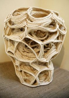 Judy Tadman creates abstract sculptural works made by knotting ropes and fibers using crochet techniques