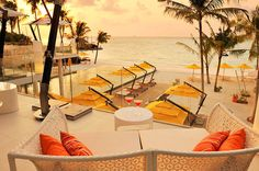 Hotels  Yellow  Canopy  White  Floor  Small  White  Tube  Coffe  Table  Rattan  Arm  Chair  Evening  View  In  Niyama  Hotel  Maldives  Show  Amazing  Landscape  Blue  Ocean Sweet Deluxe Hotel in Maldives with a Tailored Ambience Suited for the Modern Traveler