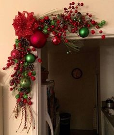 Truly Gorgeous Indoor Christmas Decoration Ideas Red and green wreath at the corner of door.Red and green wreath at the corner of door. Indoor Christmas Decorations, Christmas Swags, Noel Christmas, Christmas Centerpieces, Green Christmas, Outdoor Christmas, Christmas Colors, Christmas Ornaments, Christmas 2019