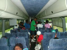 students in comfortable seating on the D Travel Motor Coach on their way to Washington, DC. They're all excited.