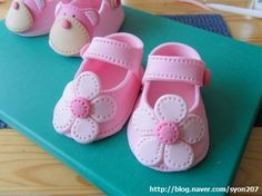 *SUGAR ART ~ Deborah Hwang Cakes: How to make fondant baby shoes....something like this would make a cute first Christmas ornament.