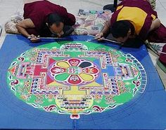 Tibetan monks creating a sand mandala. Reminds me of a scene in the movie Kundun. If you haven't seen it yet, I highly recommend it.