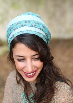 The Romantic Mint head covering is made of a combination of mint colored fabrics. The volume of the head covering as shown on the model is completely natural, no additional volumizers required! It can be worn to cover all or some of your hair. (The headc