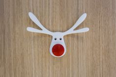 3D printed reindeer hanger is a fun project you can do with your kids. Click on this image and download or customize the file for your printer. #christmas #decor #hanger #reindeer #rudolph #rednose #coathanger #kids #3dprinting #3dprint #3dmodel #3d #deckthehalls #decor #diy #diyproject #diyhomedecor
