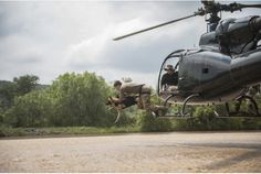 Venom and handler Marius van Heerden leap out of a helicopter hovering above a dam during a rapid deployment training simulation at the Battle Creek K9 Breeding and Training Center in South Africa. Description from thestar.com. I searched for this on bing.com/images