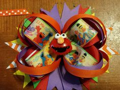 Check out this item in my Etsy shop https://www.etsy.com/listing/213599887/sesame-street-stacked-boutique-bow