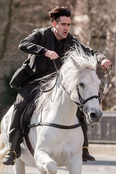 """Colin Farrell rode in on a white horse while filming his new movie Winter's Tale in Brooklyn, New York on Feb. The movie is """"a fantasy story set in Century and present-day Manhattan and revolves around a thief, a dying girl, and a flying white horse. Famous Movies, Good Movies, Movie Photo, I Movie, Knight On Horse, Winter's Tale, British Boys, Colin Farrell, Fantasy Story"""