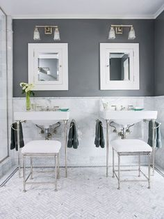 Gray walls accent the veins in the marble wainscoting and floor of this stylish bathroom: http://www.bhg.com/bathroom/color-schemes/colors/bathroom-color-ideas/?socsrc=bhgpin022215graywhite&page=9