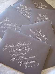 Love the white calligraphy.  Love the Gray paper.  Love that it's on a diagonal. what a fantastic idea for fancy addresses.
