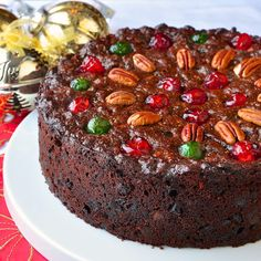 This Old English Fruitcake is dark and moist with plenty of spices and packed with plenty of sweet glacé fruit. It's been a Christmas tradition in my family for decades.