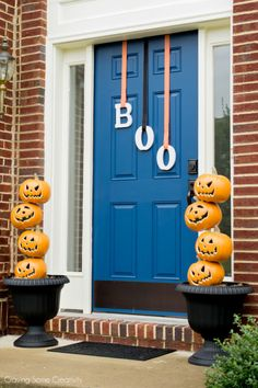 Getting Ready for Trick or Treaters Halloween Decorations for the front door with light up pumpkin stacked on a rod and BOO door letters Diy Halloween Door Decorations, Halloween Door Hangers, Halloween Home Decor, Halloween Crafts, Halloween Fabric, Halloween Veranda, Fete Halloween, Outdoor Halloween, Halloween Witches