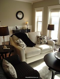 gorgeous reclining loveseat in living room traditional with revere pewter paint next to picture frame molding alongside black and white decor and window black beige living room