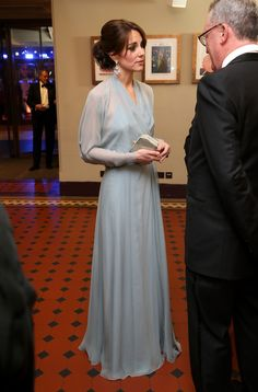 """Catherine, Duchess of Cambridge meets charity representatives as she attends The Cinema and Television Benevolent Fund's Royal Film Performance 2015 of the 24th James Bond Adventure, """"Spectre"""" at Royal Albert Hall on October 26, 2015 in London, England."""