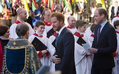 Prince William, far right, and Prince Harry pictured talking to choristers and church lead...