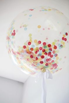 Confetti party: clear balloons with tissue paper confetti